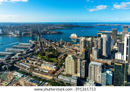 Aerial photo of Sydney CBD with skyline and Harbour bridge. Sydney iconic Harbour Bridge and CBD office buildings. Bird's eye view from above on Sydney CBD and Sydney Harbour - stock photo