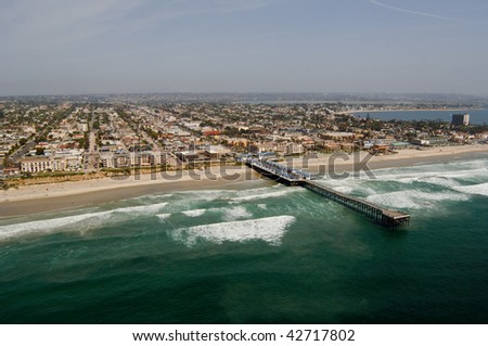 Aerial photograph of the Pacific Beach region of San Diego, California.  Crystal Pier is in the foreground. - stock photo