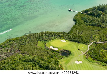 Aerial picture of Mauritius Island. Aerial view of golf course and lagoon in Mauritius - stock photo
