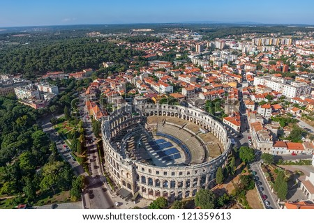 Aerial shoot of Arena ancient Roman amphitheater - Old town Pula, Istra region, Croatia. - stock photo