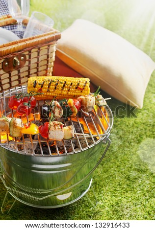Aerial shot of En brochette and Corn Cob on a grilling pan - stock photo