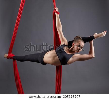 Aerial silk. Graceful girl dancing in studio - stock photo