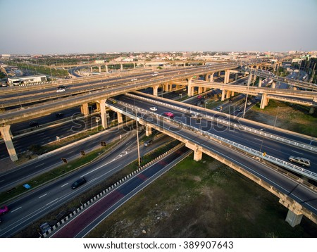 Aerial view above the inter-city expressway and ring road systems on the outer edge of Bangkok Metropolitan. - stock photo