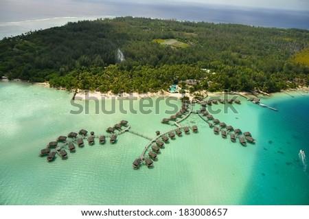 aerial view at Bora Bora island, the lagoon and its islands - stock photo