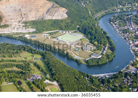 Aerial View : Channeling site along a river close by a big quarry - stock photo