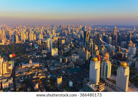 Aerial view city downtown with clear blue sky during sunset - stock photo