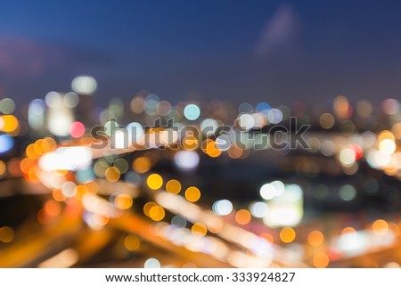 Aerial view city road intersection, blurred bokeh light background - stock photo