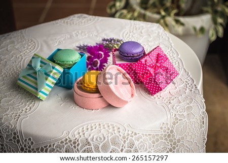 Aerial view colorful french macarons food in vintage style boxes Delicious biscuit merinque from France in small retro gift box with lilac lavender on lace table for bakery business website blog book - stock photo