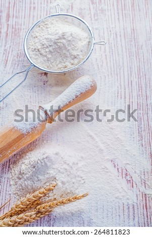 aerial view flour sieve wheat ears roling pin food and drink concept  - stock photo