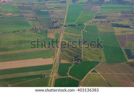 Aerial view from airplane over farm field in Italy - stock photo
