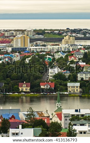 Aerial view from Hallgrimskirkja church on Reykjavik downtown and harbor, Iceland - stock photo
