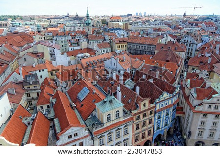 Aerial view: Houses with traditional red roofs in Prague. Prague (Praha) is capital and largest city of Czech Republic and historical capital of Bohemia. - stock photo