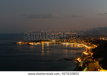 Aerial view in the evening at the Sicilian coast near Taormina at Sicily, Italy - stock photo
