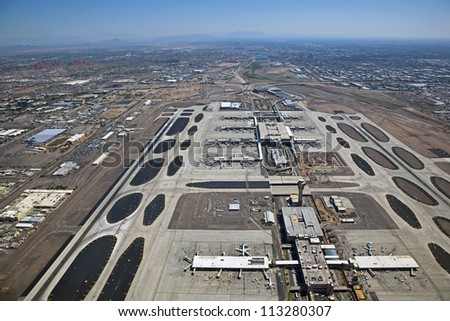 Aerial view looking east atop Sky Harbor Airport in Phoenix towards Tempe, Mesa and Scottsdale, Arizona - stock photo