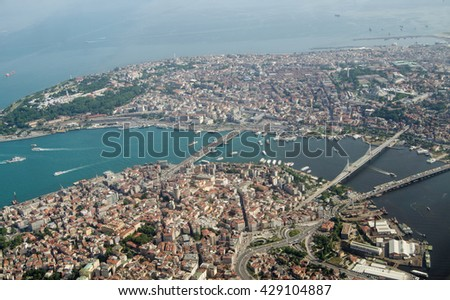 Aerial view looking south across Istanbul across the Golden Horn waterway towards the old city and the Marmara Sea beyond.  Crossing the Golden Horn are the Galata, Ataturk and Halic bridges. - stock photo