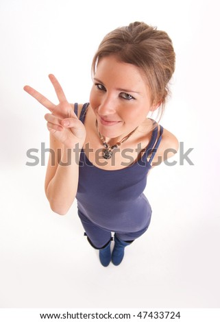Aerial view of a cute young girl showing the victory sing - stock photo