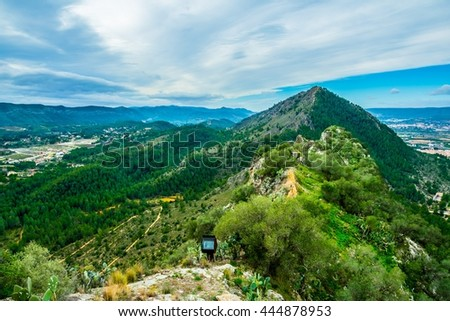aerial view of a green hilltop next to the xativa castle in spain - stock photo
