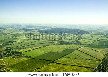 Aerial view of a green rural area under blue sky. Moldova - stock photo