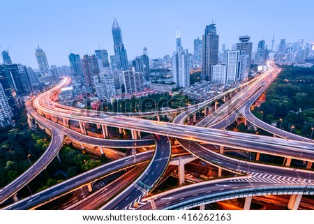 Aerial view of a highway overpass at night in Shanghai -  China.  - stock photo
