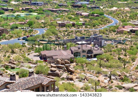 Aerial View of a House in Scottsdale, Arizona from the Top of Pinnacle Peak Mountain  - stock photo