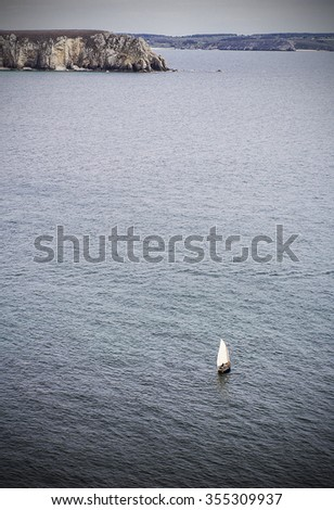 Aerial view of a lonely boat traveling in the ocean - stock photo
