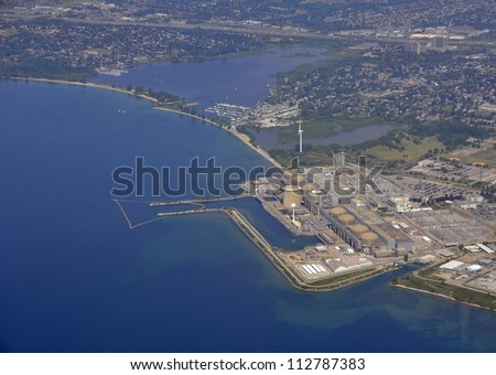 aerial view of a nuclear power plant located on the shore of Lake Ontario, Pickering Ontario Canada - stock photo
