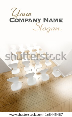 Aerial view of a room with rows of white chairs carefully arranged and lots of copy space - stock photo