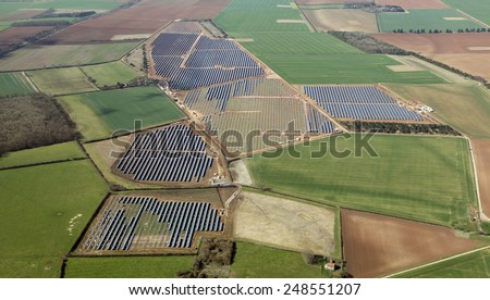 aerial view of a solar farm under construction in the UK - stock photo