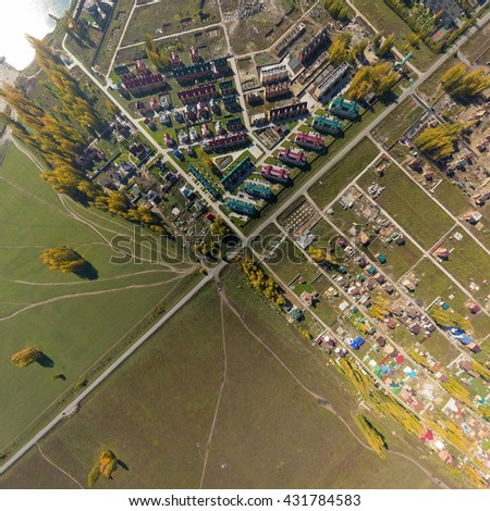 Aerial view of a summer house village at ocean coast. Blue sea. - stock photo