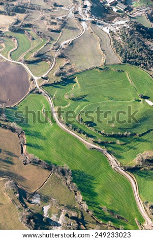 Aerial view of agricultural fields in La Garrotxa, Catalonia - stock photo