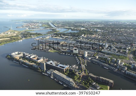 Aerial view of Amsterdam Zeeburg and the KNSM EILAND. Islands built with apartments and flats in the Dutch capital in the river IJ. - stock photo