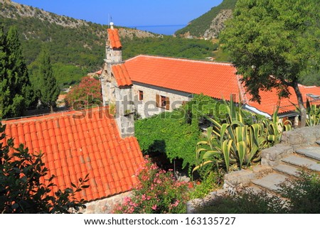 Aerial view of an orthodox monastery near the Adriatic sea - stock photo