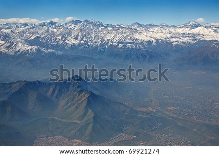 aerial view of Andes and Santiago with smog, Chile - stock photo