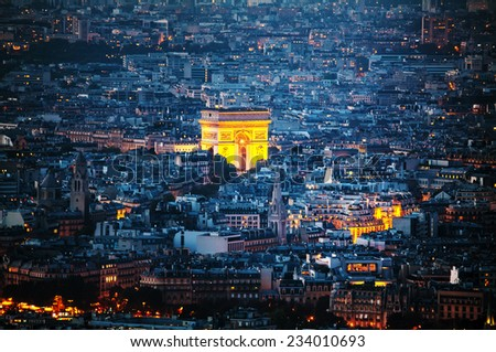 Aerial view of Arc de Triomphe de l'Etoile (The Triumphal Arch) in Paris at night - stock photo