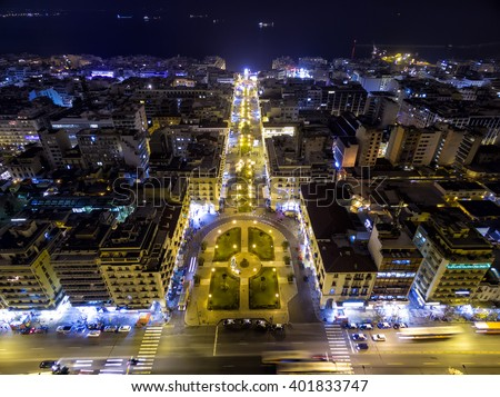 Aerial view of Aristotelous Square and the northern Greek city Thessaloniki at night. Image taken with action drone camera causing distortion and blur. - stock photo