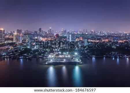 Aerial view of Bangkok along Chaophraya River intwilight - stock photo
