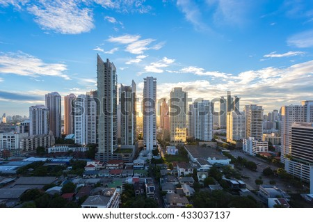 Aerial view of Bangkok modern office buildings, condominium in Bangkok city downtown with sunset sky , Bangkok , Thailand - stock photo
