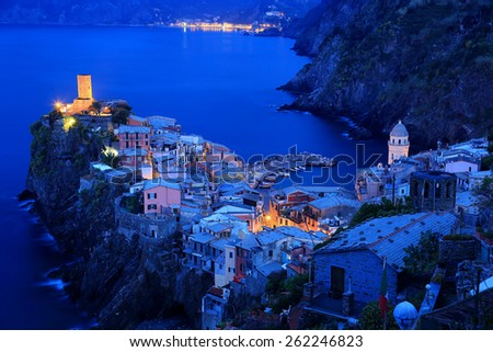 Aerial view of beautiful Vernazza in morning twilight ~ an amazing village perched on cliff by the rocky coast in Cinque Terre Italy - stock photo