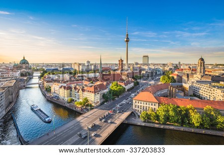 Aerial view of Berlin skyline with famous TV tower and Spree river in beautiful evening light at sunset in summer, Germany - stock photo