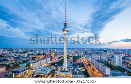 Aerial view of Berlin skyline with famous TV tower at Alexanderplatz and dramatic cloudscape in twilight during blue hour at dusk, Germany - stock photo