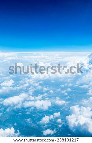 Aerial view of Blue sky and Cloud Top view from airplane window,Nature background - stock photo