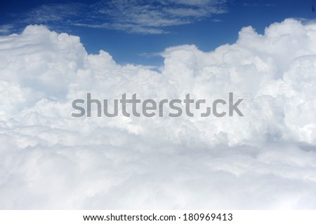aerial view of blue sky with clouds from jet flight - stock photo