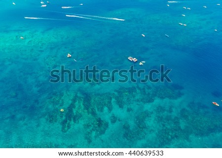 Aerial view of boats in the tropical sea - stock photo