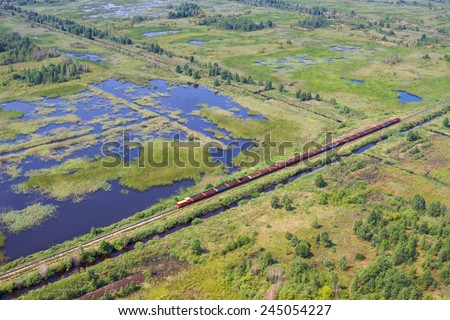 Aerial view of bog landscape and train with turf  - stock photo