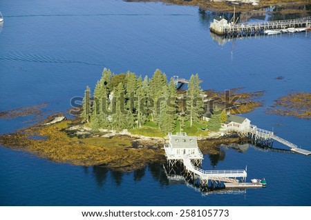 Aerial view of Boothbay Harbor and island on Maine coastline - stock photo
