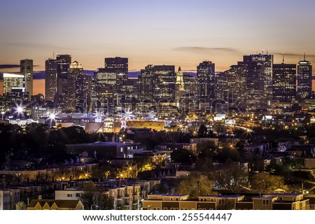 Aerial view of Boston in Massachusetts, USA at sunset showcasing the architecture of its Financial District. - stock photo