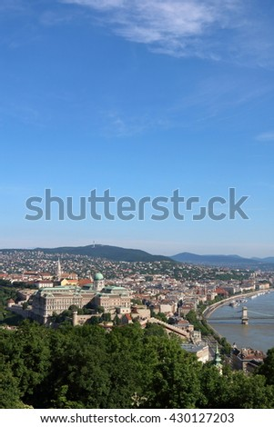 Aerial view of Buda side of Budapest, with castle hill, Danube River and Chain Bridge in sight, in vertical format - stock photo