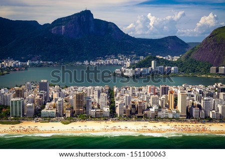 Aerial view of buildings on the beach front with a mountain range in the background, Ipanema Beach, Rio De Janeiro, Brazil - stock photo