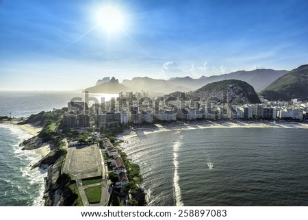 Aerial view of buildings on the Copacabana Beach in Rio de Janeiro with sunlight, Brazil - stock photo