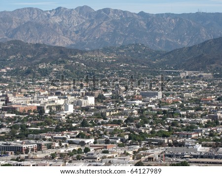 Aerial view of Burbank, CA and the San Gabriel Mountains from Griffith Park - stock photo